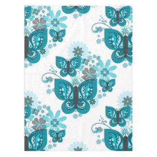 Nappe (bleue) de papillons et de fleurs
