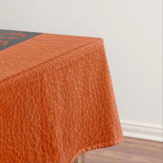 Nappe Lea noire et orange de masque indigène et de motif