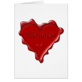 Nicholas. Joint rouge de cire de coeur avec Carte De Vœux