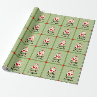 Noël faisant de la planche à roulettes papier cadeau noël