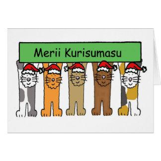 Noël japonais avec des chats dans des chapeaux de cartes de vœux