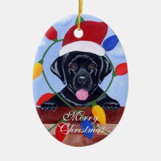 Noël noir très mignon de chiot de Labrador Ornement Ovale En Céramique