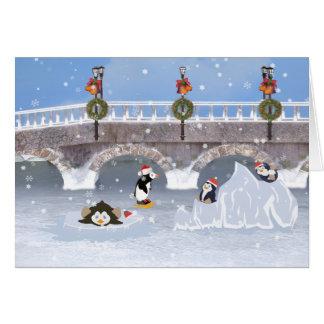 Noël, pingouins espiègles sur le lac congelé carte de vœux