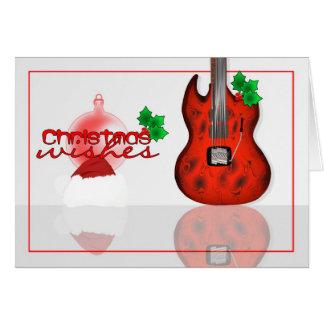 Noël souhaite la carte avec la guitare
