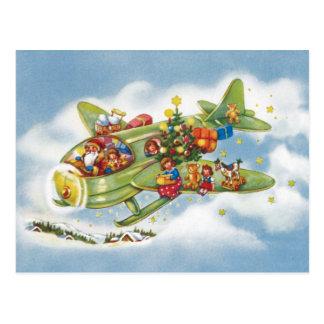 Noël vintage, le père noël pilotant son avion carte postale