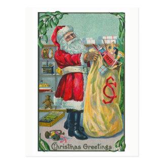 Noël vintage, le père noël victorien avec des carte postale