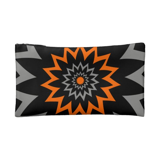 Noir de floraison et orange trousse make-up