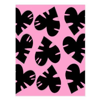 Noir de luxe de feuille sur le rose carte postale