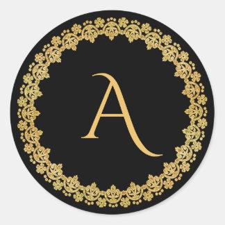 Noir et autocollant de monogramme de Noël d'or