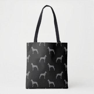 Noir et gris de motif de silhouettes de chien de sac