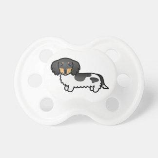 Noir et long chien pie bronzage de teckel de tétine