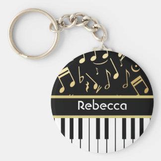 Noir et or de notes musicales et de clés de piano porte-clef