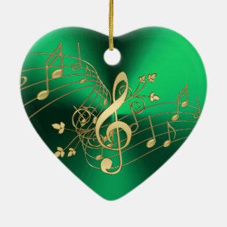 Notes de musique et ornement verts de Noël de clef