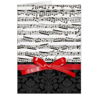 Notes de musique et ruban de rouge de faux carte de vœux