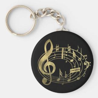 Notes musicales d'or dans la forme ovale porte-clé rond