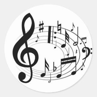 Notes musicales noires dans la forme ovale autocollant