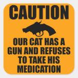 Notre chat a une arme à feu autocollants carrés