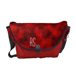 Nuages rouges décorés d'un monogramme sacoches