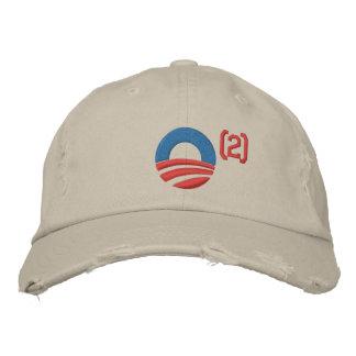 Obama a ajusté la casquette de baseball