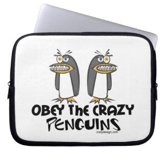 Obéissez les pingouins fous ! housses pour ordinateur portable