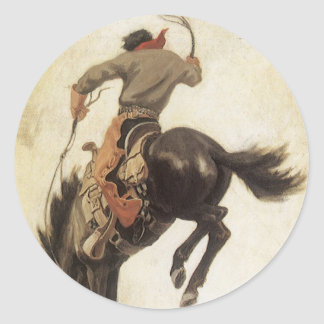 Occidental vintage, cowboy sur un cheval sticker rond