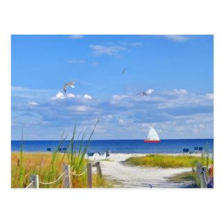 Océan, plage, et carte postale de voilier