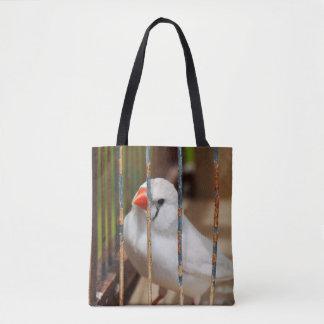Oiseau blanc de pinson de zèbre dans la cage sac