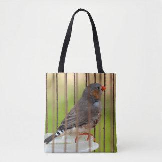 Oiseau de pinson de zèbre dans la cage sac