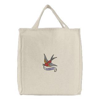 Oiseau de tatouage avec le sac brodé par bannière