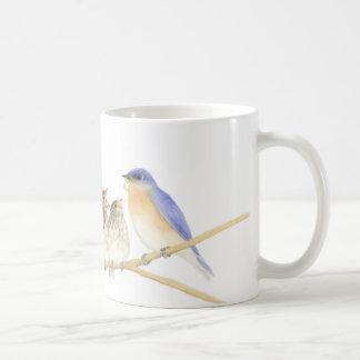 Oiseaux bleus dans la tasse d'aquarelle