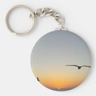 Oiseaux de coucher du soleil porte-clé rond