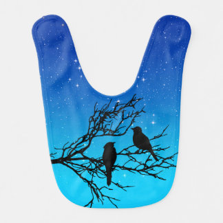 Oiseaux sur une branche, noire contre même le bleu bavoir pour bébé