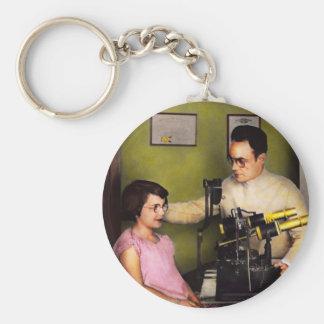Optométriste - l'examen de la vue 1929 porte-clés
