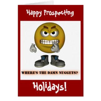 Or heureux prospectant des cartes de Noël de
