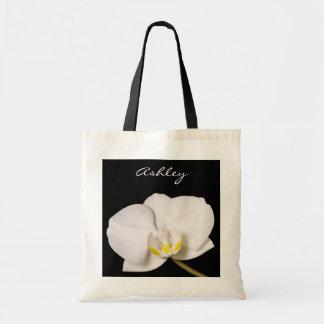 Orchidée blanche sur le noir sac fourre-tout