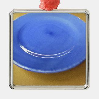 Ornement Carré Argenté Plat en céramique bleu de couleur vide sur le