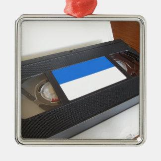 Ornement Carré Argenté Vidéocassette périmée. Vieille cassette vidéo sur