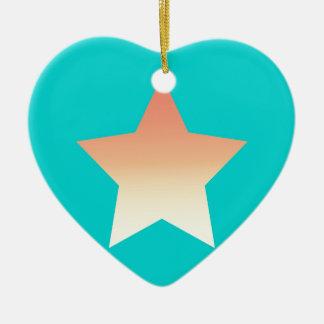 Ornement Cœur En Céramique Étoile orange lumineuse sur le bleu