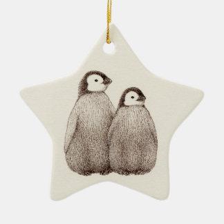 Ornement d'étoile de frères de pingouin de bébé