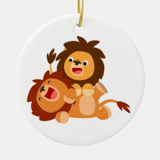 Ornement espiègle mignon de deux lions de bande