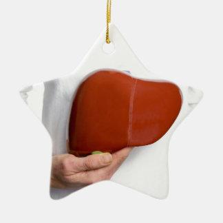 Ornement Étoile En Céramique Femme tenant le modèle humain de foie au corps