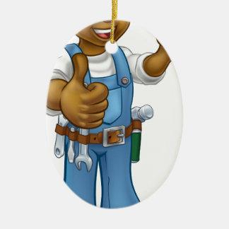 Ornement Ovale En Céramique Bricoleur de mécanicien ou de plombier avec la clé