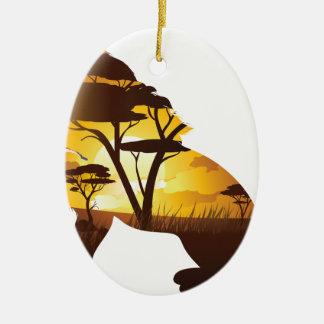 Ornement Ovale En Céramique Coucher du soleil africain avec le lion