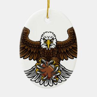 Ornement Ovale En Céramique Le football américain d'Eagle folâtre la mascotte