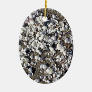 Ornement Ovale En Céramique Les coquillages l'été de sable échouent la vue