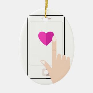 Ornement Ovale En Céramique Les filles remettent avec le mobile et aiment