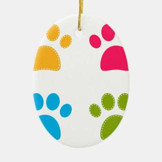 Ornement Ovale En Céramique Les pattes merveilleuses de chiens ont coloré