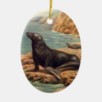 Ornement Ovale En Céramique Otarie vintage par le bord de la mer, mammifère