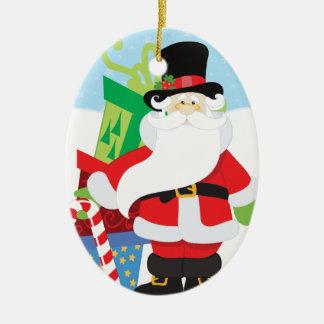Ornement Ovale En Céramique père Noël dans le tophat par la pile de presentts
