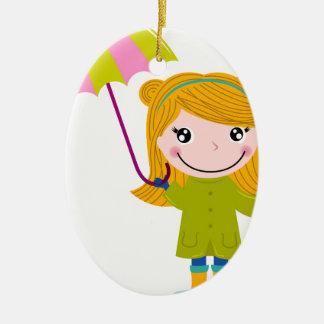 Ornement Ovale En Céramique Petite fille pluvieuse mignonne. Illustration